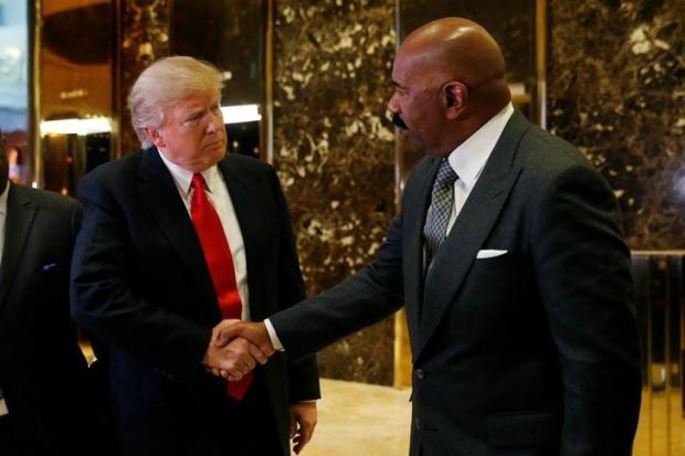 U.S.President-elect Donald Trump shakes hands with television personality Steve Harvey after their meeting at Trump Tower in New York